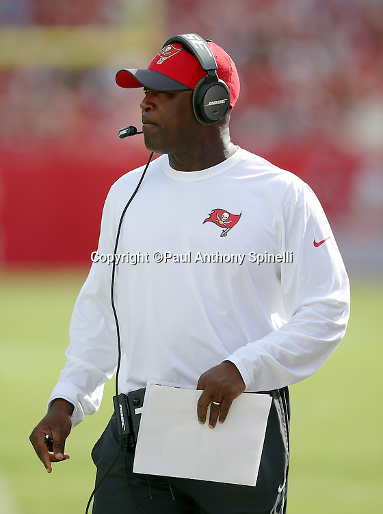 Tampa Bay Buccaneers head coach Lovie Smith looks on from the sideline during the 2015 week 14 regular season NFL football game against the New Orleans Saints on Sunday, Dec. 13, 2015 in Tampa, Fla. The Saints won the game 24-17. (©Paul Anthony Spinelli)