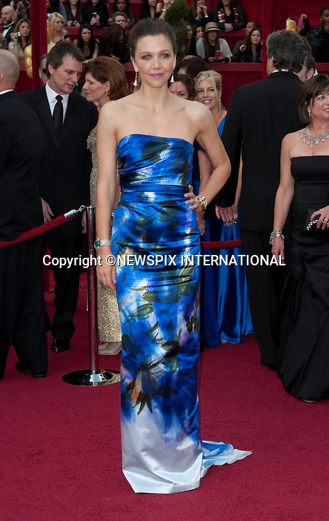 "OSCARS 2010 RED CARPET ARRIVALS_MAGGIE GYLLENHAAL.The 82nd Academy Awards  arrivals took place under a transparent tent to keep the red carpet dry from the pending rain_ Kodak Theatre, Hollywood, Los Angeles_07/03/2009.Mandatory Photo Credit: ©Dias/Newspix International..**ALL FEES PAYABLE TO: ""NEWSPIX INTERNATIONAL""**..PHOTO CREDIT MANDATORY!!: NEWSPIX INTERNATIONAL(Failure to credit will incur a surcharge of 100% of reproduction fees)..IMMEDIATE CONFIRMATION OF USAGE REQUIRED:.Newspix International, 31 Chinnery Hill, Bishop's Stortford, ENGLAND CM23 3PS.Tel:+441279 324672  ; Fax: +441279656877.Mobile:  0777568 1153.e-mail: info@newspixinternational.co.uk"