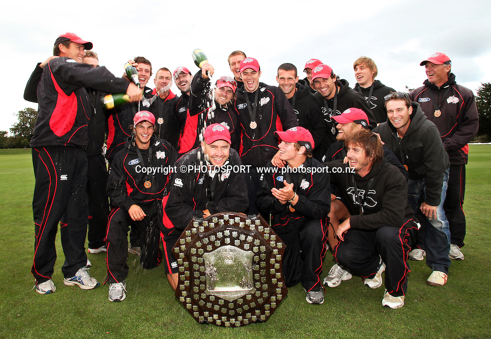 The Canterbury team celebrate winning the Plunket Shield after beating the Northern Knights on the final day. Canterbury Wizards v Northern Knights, Plunket Shield Game held at Mainpower Oval, Rangiora, Thursday 07 April 2011. Photo : Joseph Johnson / photosport.co.nz