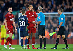 LIVERPOOL, ENGLAND - Sunday, October 7, 2018: Liverpool's Virgil van Dijk speaks with referee Martin Atkinson after the FA Premier League match between Liverpool FC and Manchester City FC at Anfield. (Pic by David Rawcliffe/Propaganda)