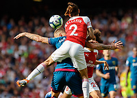 Football - 2018 / 2019 Premier League - Arsenal vs. West Ham United<br /> <br /> Hector Bellerin (Arsenal FC) climbs all over the back of Marko Arnautovic (West Ham United) to head clear at The Emirates.<br /> <br /> COLORSPORT/DANIEL BEARHAM