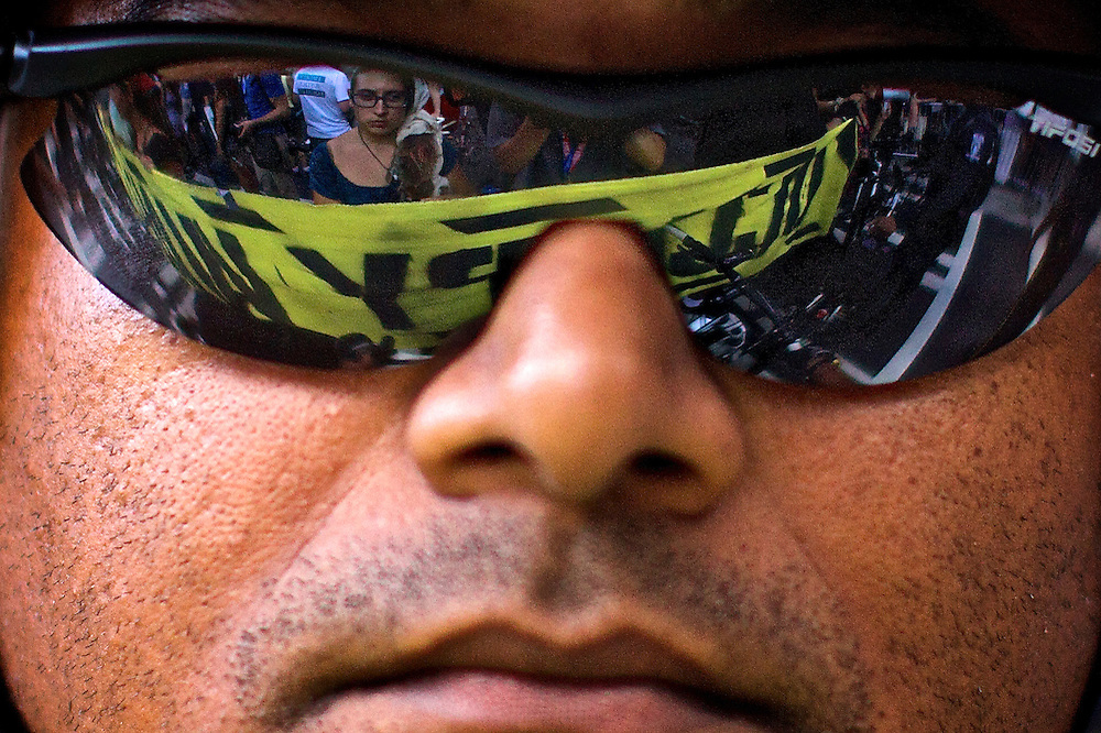 Occupy Wall Street protestors are reflected in a police officer's sunglasses in Charlotte, NC during the 2012 Democratic National Convention on Sept. 5, 2012.