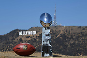 General overall view of Lombardi Trophy and NFL official Wilson Duke football with the Hollywood sign and Mount Lee as a backdrop in Los Angeles, Wednesday, Sept. 19, 2018. Super Bowl I and VII were played at the Los Angeles Memorial Coliseum.The NFL championship game will return to Los Angeles for Super Bowl XLVI at LA Stadium at Hollywood Park in Inglewood, Calif. in 2022.