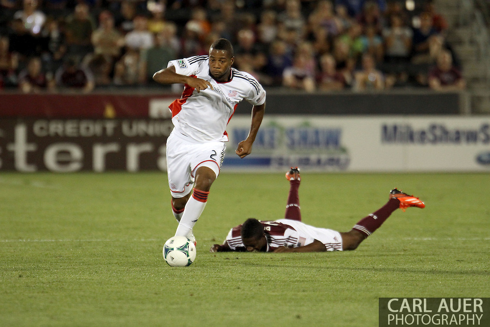 July 17th, 2013 - New England Revolution defender Andrew Farrell (2) charges hard with the ball past the fallen Colorado Rapids forward Deshorn Brown (26) in the second half of the Major League Soccer match between the New England Revolution and the Colorado Rapids at Dick's Sporting Goods Park in Commerce City, CO
