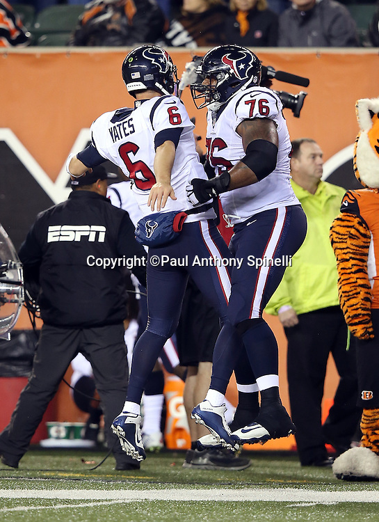 Houston Texans quarterback T.J. Yates (6) chest bumps in celebration with Houston Texans tackle Duane Brown (76) after throwing a 22 yard touchdown pass to Houston Texans wide receiver DeAndre Hopkins (10) for a 10-6 fourth quarter Texans lead during the 2015 week 10 regular season NFL football game against the Cincinnati Bengals on Monday, Nov. 16, 2015 in Cincinnati. The Texans won the game 10-6. (©Paul Anthony Spinelli)