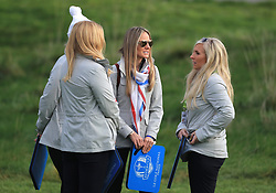 Erica Stoll (centre) watches the action during the Fourballs match on day one of the Ryder Cup at Le Golf National, Saint-Quentin-en-Yvelines, Paris.