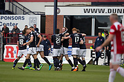 5th May 2018, Dens Park, Dundee, Scotland; Scottish Premier League football, Dundee versus Hamilton Academical; Kevin Holt of Dundee is congratulated after scoring by Roarie Deacon