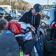 WOODSTOCK, VA - MAR 3: Marcus pins a number on Ben's back before the first stage, a short, uphill time trial, on Saturday, Mar. 4, 2017 in Woodstock, Ga. (Photo by Jay Westcott/The News & Advance)