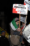London 04/01/09: Protests outside the Israeli Embassy in London UK: A young child enjoys the occasion