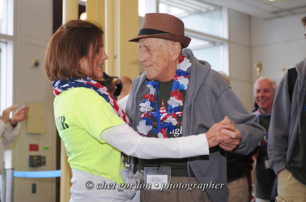 WWII Veterans and their escorts onboard the Hudson Valley Honor Flight #10 arrive at Reagan National Airport in Arlington, VA on Saturday, November 7, 2015. Sixty-four veterans from the Westchester County (NY) area toured the WWII and Marine Corps War Memorials, as well as Arlington National Cemetery. Hudson Valley Honor Flight is a chapter of the Honor Flight Network, which provides free flights for WWII Veterans and tours of the WWII Memorial constructed in their honor, and other sites in the nation's capital.  © Chet Gordon / Hudson Valley Honor Flight