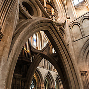 Interior arches of Wells Cathedral in Wells, Somerset, United Kingdom. Some of the building dates back to the 10th Century.