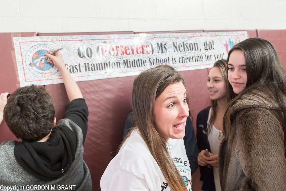 Cara Nelson, center, a 7th grade social studies teacher at the East Hampton Middle School, speaks with students, during a sendoff in her honor, at the school in East Hampton, Jan. 18, 2018. Nelson will leave next week to participate in a trip where she will run seven marathons in seven days on seven continents.