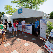 August 20, 2014, New Haven, CT:<br /> The Guest Services booth with Destination signage is shown on day six of the 2014 Connecticut Open at the Yale University Tennis Center in New Haven, Connecticut Tuesday, August 19, 2014.<br /> (Photo by Billie Weiss/Connecticut Open)