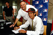 Orioles Director of international scouting David Stockstill with Pita Rona, New Zealand baseball player Pita Rona signs with American Major League Baseball team the Baltimore Orioles. Sky City Grand hotel, Auckland. 19 January 2012. Photo: William Booth/photosport.co.nz