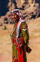 A Bedouin Desert Patrol policeman, at the Royal Tombs,  Petra archaeological site (a UNESCO World Heritage site), Petra, Jordan.