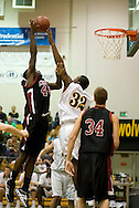1/6/2006: Julius McMillion of the Central Washington Wildcats goes for two over Junior forward Joe Davis (32) of the UAA Seawolves as Anchorage goes on to beat the visiting Central Washington Wildcats, 80-60 at the Wells Fargo Sports Complex on the campus of UAA.<br />