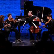 """February 9, 2015 - New York, NY : From left, violinists Michelle Kim and Yulia Ziskel; cellist Nathan Vickery; and violist Rémi Pelletier perform Josef Bardanashvili's 'Quasi danza macabra from String Quartet No. 1' as part of The New York Philharmonic and the 92nd Street Y's presentation of """"Contact! New Music from Israel"""" at SubCulture in Manhattan on Monday night.  CREDIT: Karsten Moran for The New York Times"""