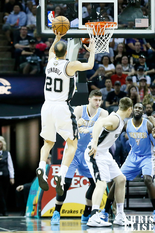 03 April 2015: San Antonio Spurs guard Manu Ginobili (20) takes a jump shot during the San Antonio Spurs 123-93 victory over the Denver Nuggets , at the AT&T Center, San Antonio, Texas, USA.