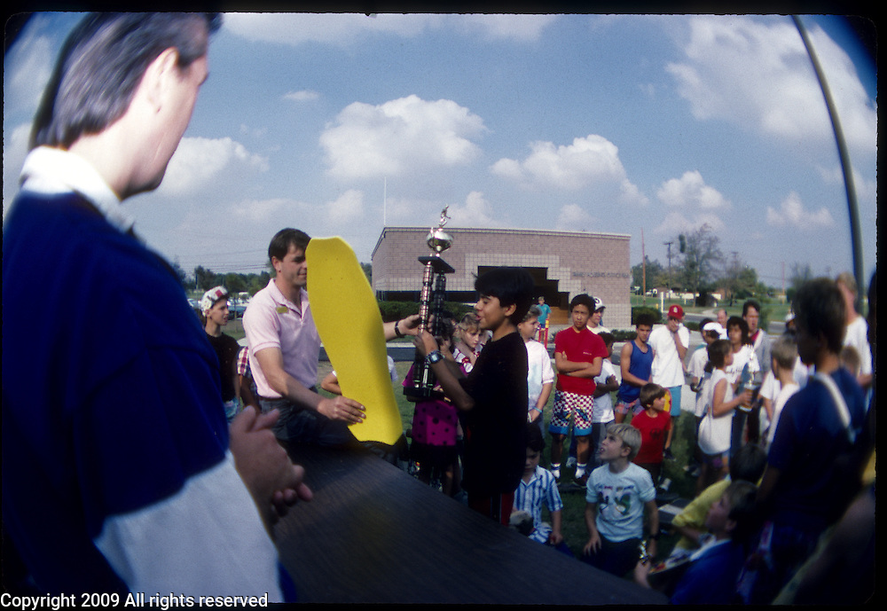 A trophy is awarded after a skateboarding contest at the Naval Airforce Station in Lemoore, California in 1987.