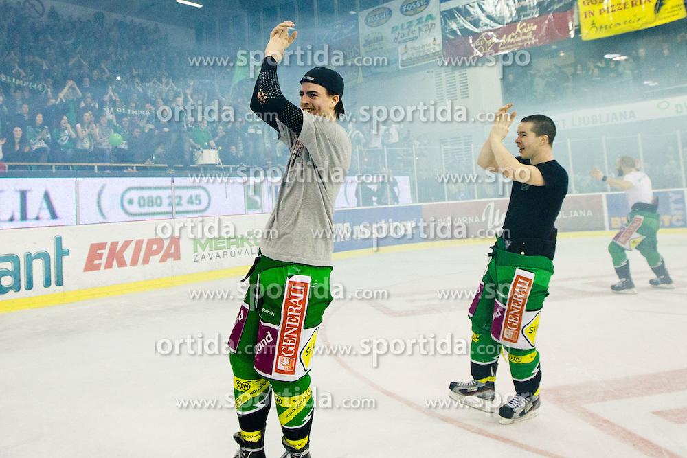 Miha Verlic (HDD Tilia Olimpija, #91) and Ken Ograjensek (HDD Tilia Olimpija, #18) celebrate during ice-hockey match between HDD Tilia Olimpija and SAPA Fehervar AV19 at sixth match in Quarterfinal  of EBEL league, on March 1, 2012 at Hala Tivoli, Ljubljana, Slovenia. HDD Tilia Olimpija won 4:3 and advanced to semifinal. (Photo By Matic Klansek Velej / Sportida)