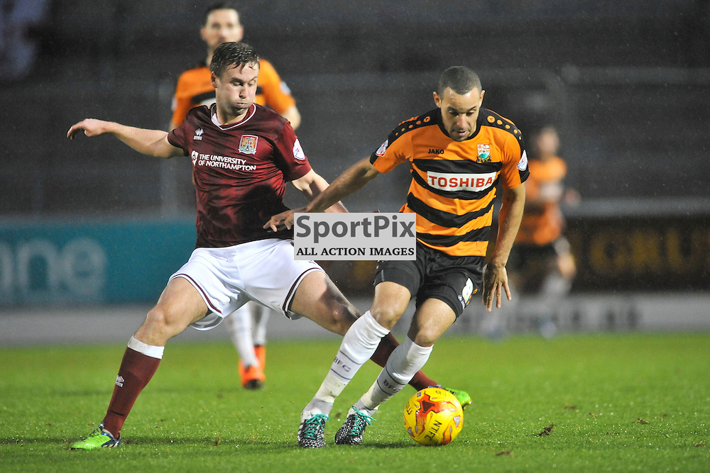 Northamptons Joel Byrom holds of Barnets Curtis Weston, Northampton Town v Barnet FC, Sixfields Stadium, Sky Bet League Two, Saturday 2nd January 2016