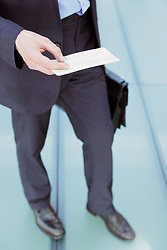 Dec. 05, 2012 - Businessman checking airline ticket (Credit Image: © Image Source/ZUMAPRESS.com)
