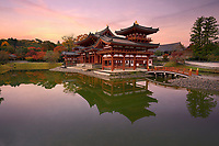Phoenix Hall, Amida hall of Byodoin Buddhist temple amidst Jodoshiki teien, Pure Land garden pond. Beautiful sunrise scenery. Uji, Kyoto Prefecture, Japan 2017