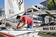 World Sailing Emerging Nations Program - Boca Chica Sailing Club, Santo Domingo 08/19/2017 - DAY 2 - Luis Pedro Carrero from Uruguay sets up his boat at the beginning of the competition day