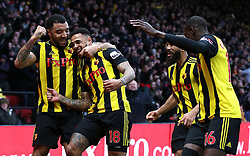 Watford's Andre Gray (centre left) celebrates scoring his side's first goal of the game with team mates during the Premier League match at Vicarage Road, Watford.