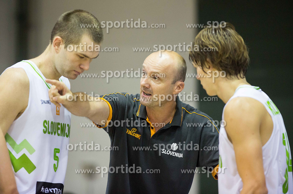 Jure Zdovc, head coach of Slovenia talks to Uros Slokar of Slovenia and Jaka Klobucar of Slovenia during friendly basketball match between National teams of Slovenia and Ukraine at day 3 of Adecco Cup 2014, on July 26, 2014 in Rogaska Slatina, Slovenia. Photo by Vid Ponikvar / Sportida.com