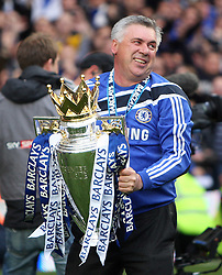 Chelsea boss Carlo Ancelotti celebrates with Premier League trophy after they win the title with a 8-0 victory over Wigan Athletic in the English Premier League football match at Stamford Bridge, West London, England, on May 9, 2010. Chelsea finished the season one pont ahead of 2009 Champions, Manchester United.