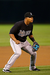 June 28, 2011; Oakland, CA, USA; Florida Marlins third baseman Jose Lopez (11) stands in the infield during the first inning against the Oakland Athletics at the O.co Coliseum.  Oakland defeated Florida 1-0.