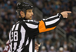 April 16, 2010; San Jose, CA, USA; NHL referee Chris Lee during the first period of game two between the San Jose Sharks and the Colorado Avalanche in the first round of the 2010 Stanley Cup Playoffs at HP Pavilion.  San Jose defeated Colorado 6-5. Mandatory Credit: Jason O. Watson / US PRESSWIRE