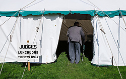 © Licensed to London News Pictures.26/08/15<br /> Egton, UK. <br /> <br /> A man enters the judges tent for lunch at the 126th Egton Show in North Yorkshire. <br /> <br /> Egton is one of the largest village shows in the country and is run by a band of voluntary helpers. <br /> <br /> This year the event featured wrought iron and farrier displays, a farmers market, plus horse, cattle, sheep, goat, ferret, fur and feather classes. There was also bee keeping, produce and handicrafts on display.<br /> <br /> Photo credit : Ian Forsyth/LNP