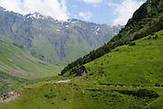 Georgia, mountain landscape as seen from the 14th century Gergeti Trinity Church (Tsminda Sameba) Holy Trinity Church near the village of Gergeti