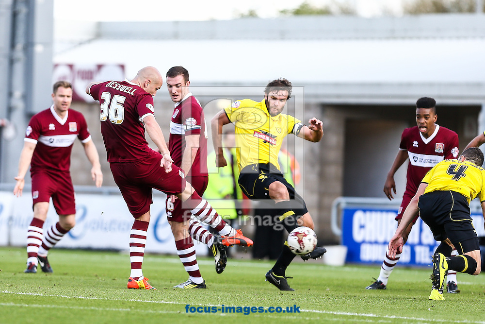 Ryan Cresswell of Northampton Town (2nd left) shoots and scores during the Sky Bet League 2 match at Sixfields Stadium, Northampton<br /> Picture by Andy Kearns/Focus Images Ltd 0781 864 4264<br /> 11/10/2014