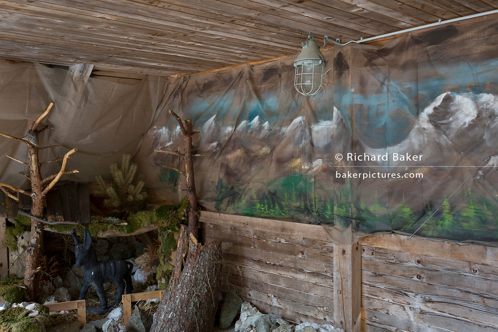 Apainted mural depicting the Slovenian Alps and rustic scenes on the wall of a rural stage, on 26th June 2018, in Kamniska Bistrica, near Kamnik, Slovenia.