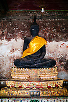 A detail of a Buddha statue inside Wat Suthat in Bangkok, Thailand.
