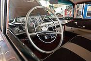 The driver's seat and interior of a 1957 Chevy Bel Air. WATERMARKS WILL NOT APPEAR ON PRINTS OR LICENSED IMAGES.
