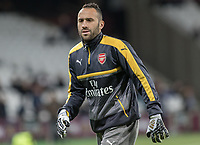 Football - 2016 / 2017 Premier League - West Ham United vs. Arsenal <br /> <br /> David Ospina of Arsenal warms up ahead of the match at The London Stadium.<br /> <br /> COLORSPORT/DANIEL BEARHAM