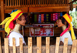 Padaung women with brass rings around their necks chat at a gift shop in Panpet Village, Demoso Township, Kayah State, Myanmar, April 11, 2016. The brass rings are first applied when the Padaung girls are about eight years old and as the girl grows older, longer coils are added up to 24 or 25 rings. EXPA Pictures © 2016, PhotoCredit: EXPA/ Photoshot/ U Aung<br /> <br /> *****ATTENTION - for AUT, SLO, CRO, SRB, BIH, MAZ, SUI only*****