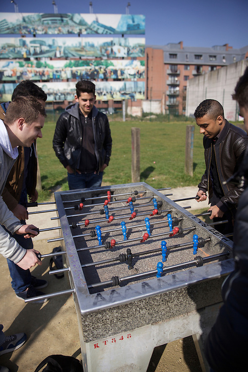 A group of young men play fussball in Brussels, Belgium.