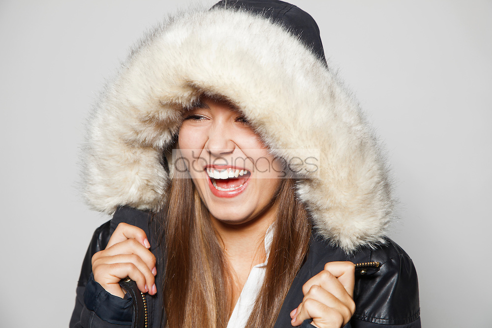 Teenage Girl Wearing Fur Trimmed Parka Smiling
