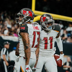 Sep 9, 2018; New Orleans, LA, USA; Tampa Bay Buccaneers wide receiver DeSean Jackson (11) and wide receiver Mike Evans (13) celebrate after a touchdown against the New Orleans Saints during the third quarter of a game at the Mercedes-Benz Superdome. The Buccaneers defeated the Saints 48-40. Mandatory Credit: Derick E. Hingle-USA TODAY Sports