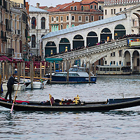 VENICE, ITALY - FEBRUARY 19: A Gondola crosses the Canal Grande near Rialto Bridge where a sign invites to Venice Carnival 2012 on February 19, 2012 in Venice, Italy.  The annual festival, which lasts nearly three weeks, will see the streets and canals of Venice filled with people wearing highly-decorative and imaginative carnival costumes and masks.  (Photo by Marco Secchi/Getty Images)