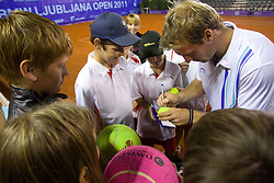 Grega Zemlja of Slovenia with young fans after winning in doubles during day six of the ATP Challenger Tour BMW Ljubljana Open 2011, on September 24, 2011, in TC Ljubljana Siska, Slovenia. (Photo by Vid Ponikvar / Sportida)