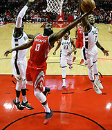Houston Rockets guard James Harden (13) drives between Milwaukee Bucks center Thon Maker, left, and guard Eric Bledsoe during the first half of an NBA basketball game, Saturday, Dec. 16, 2017, in Houston. (AP Photo/Eric Christian Smith)
