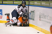 RIT forward Andrew Miller and Robert Morris defenseman Evan Moore fall to the ice during the Atlantic Hockey final at the Blue Cross Arena in Rochester on Saturday, March 19, 2016.
