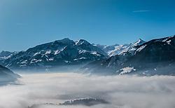 THEMENBILD, das grosse Wiesbachhorn, teile der Glocknergruppe, der Gletscher Kitzsteinhorn mit seinem Skigebiet und die Schmitten mit dem Zeller See und Zell am See im Nebel, aufgenommen in Saalfelden, Oesterreich am 11. Feber 2015 // the large Wiesbachhorn, parts of the Glocknergroup, the glacier Kitzsteinhorn with the ski area and the Schmitten with the lake Zell and the City Zell am See in the fog, Saalfelden, Austria on 2015/02/11. EXPA Pictures © 2015, PhotoCredit: EXPA/ JFK