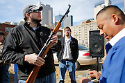 Brian Jacob of Dallas inspects a SKS semi-automatic rifle he purchased for $425 during a private auction across the street from the First Presbyterian Church of Dallas gun buy-back in The Stewpot's parking garage in Dallas, Texas, on January 19, 2013.  Jacob is a military weapons collector and would rather see unwanted guns auctioned to a new owner rather than destroyed.  (Stan Olszewski/The Dallas Morning News)